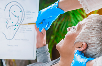 Female Chiropractor Reviewing How the Inner Ear Impacts Balance with Senior Female Patient
