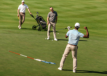 Can Chiropractic Improve Your Golf Game? Professional Male Golfer Celebrating His Improved Game as a Result of Chiropractic Care