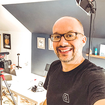 Smart Chiropractor Jeff Langmaid Takes a Smiling Selfie While Showing Off His Recording Equipment