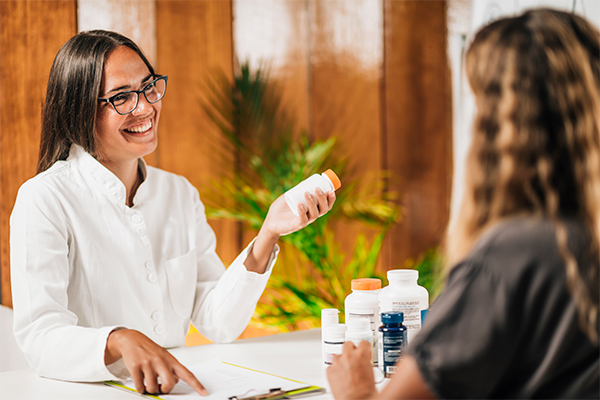 Female African American Chiropractor Recommends Supplements to Help Support Common Nutrient Deficiencies for Female Patients