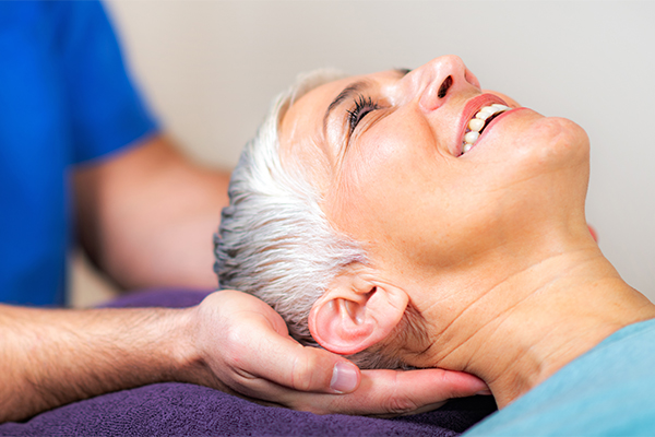 Senior Woman Lying on Adjustment Table Ready to Receive and Adjustment from Her Chiropractor for Her Suboccipital Headaches